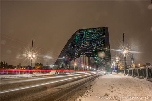 Light trails across a snowy tyne bridge (4).jpg by Steven's Shots Photography