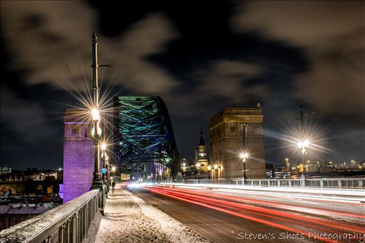 Light trails across a snowy tyne bridge (5).jpg by Steven's Shots Photography