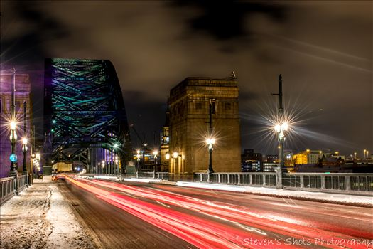 Light trails across a snowy tyne bridge (2).jpg by Steven's Shots Photography