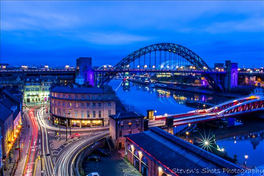 Swing Bridge and Tyne Bridge with traffic on the quayside by Steven's Shots Photography