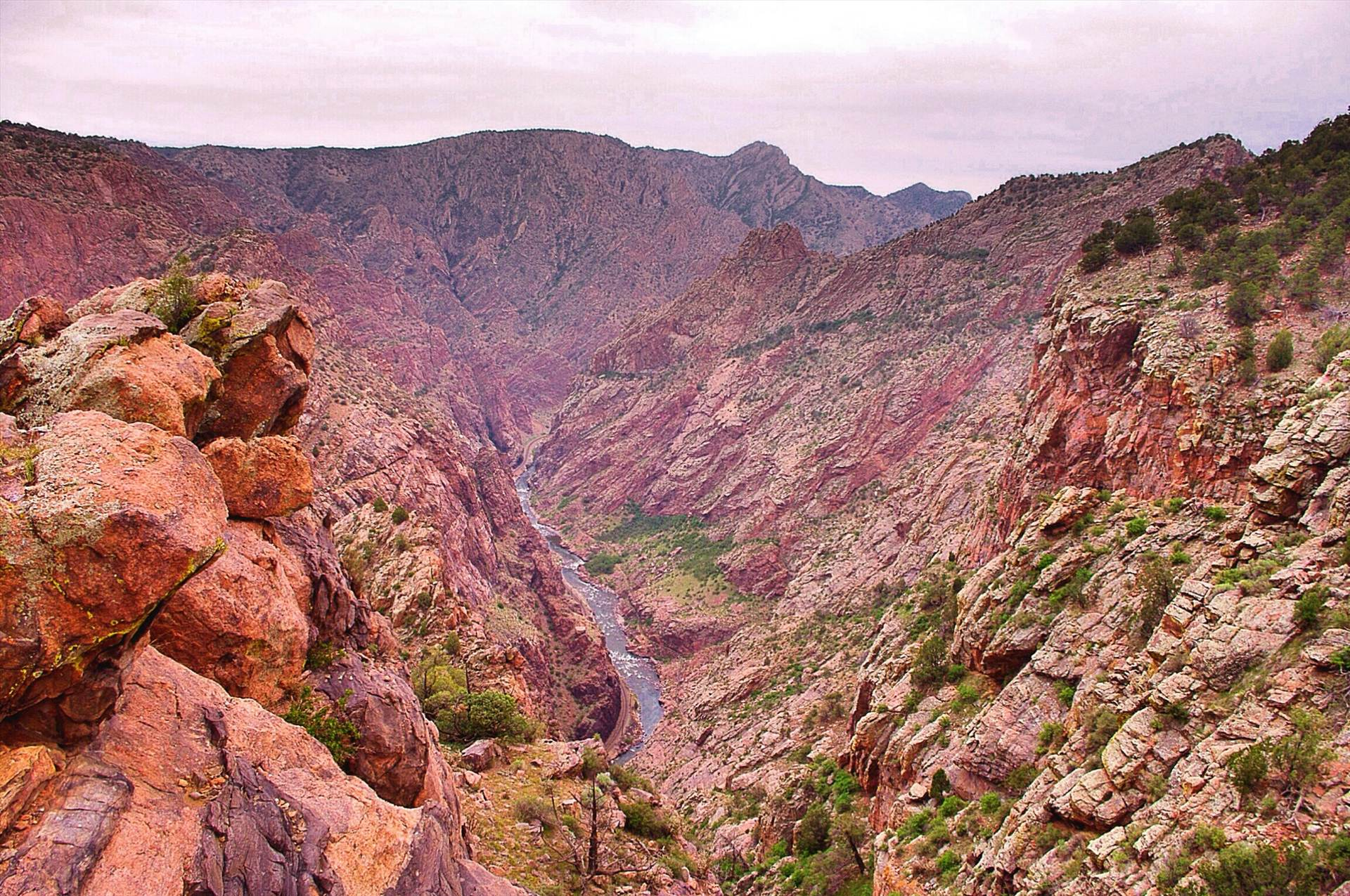 The Royal Gorge Canyon near Canon City, Colorado. The inspiring view from one of the world's highest suspension bridges - hanging 956 feet & spanning 1/4 mile across the canyon is a must see for any photographer. Take a 7 paggenger trolley across the canyon via a wire cable or choose to seek astonishing  by Tumbleweed Express