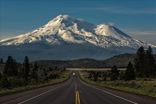 Caution: Volcano Ahead - Mt Shasta is the 5th highest peak in California. It rises abruptly to 14,179 ft. Most prominently seen are the main summit and the satellite cone known as Shastina.