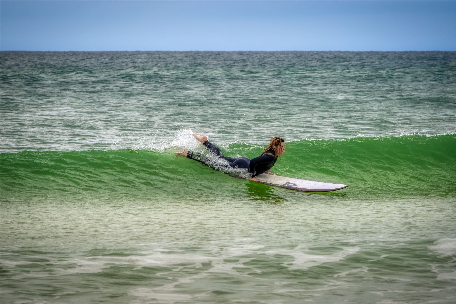 surfer girl Female surfer at St. Andrews State Park at the jetties by Terry Kelly Photography