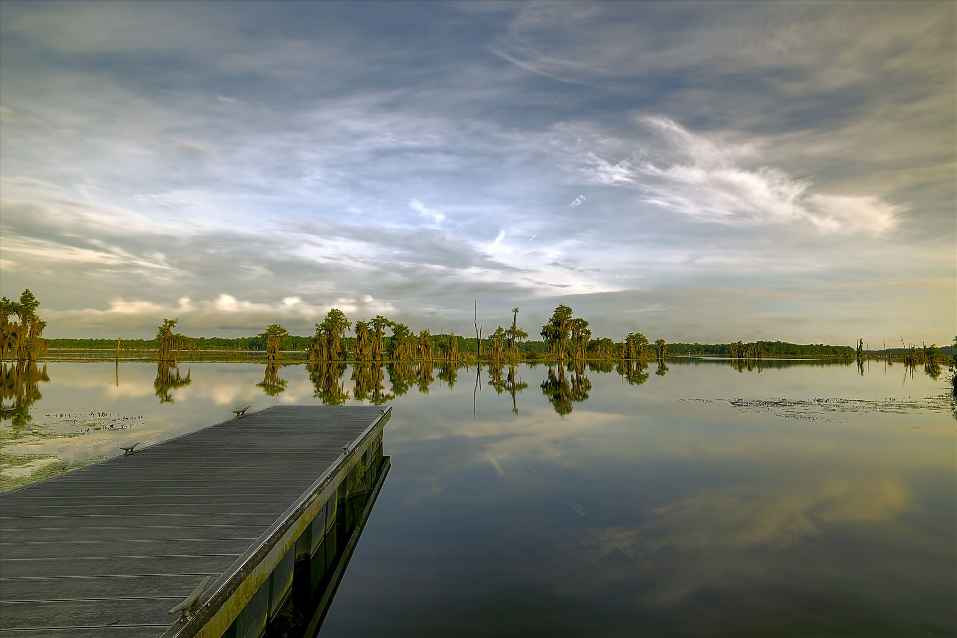 long exposure boat dock at deer point lake 8500354.jpg dock extending out into Deer Point Lake in Bay County, Florida