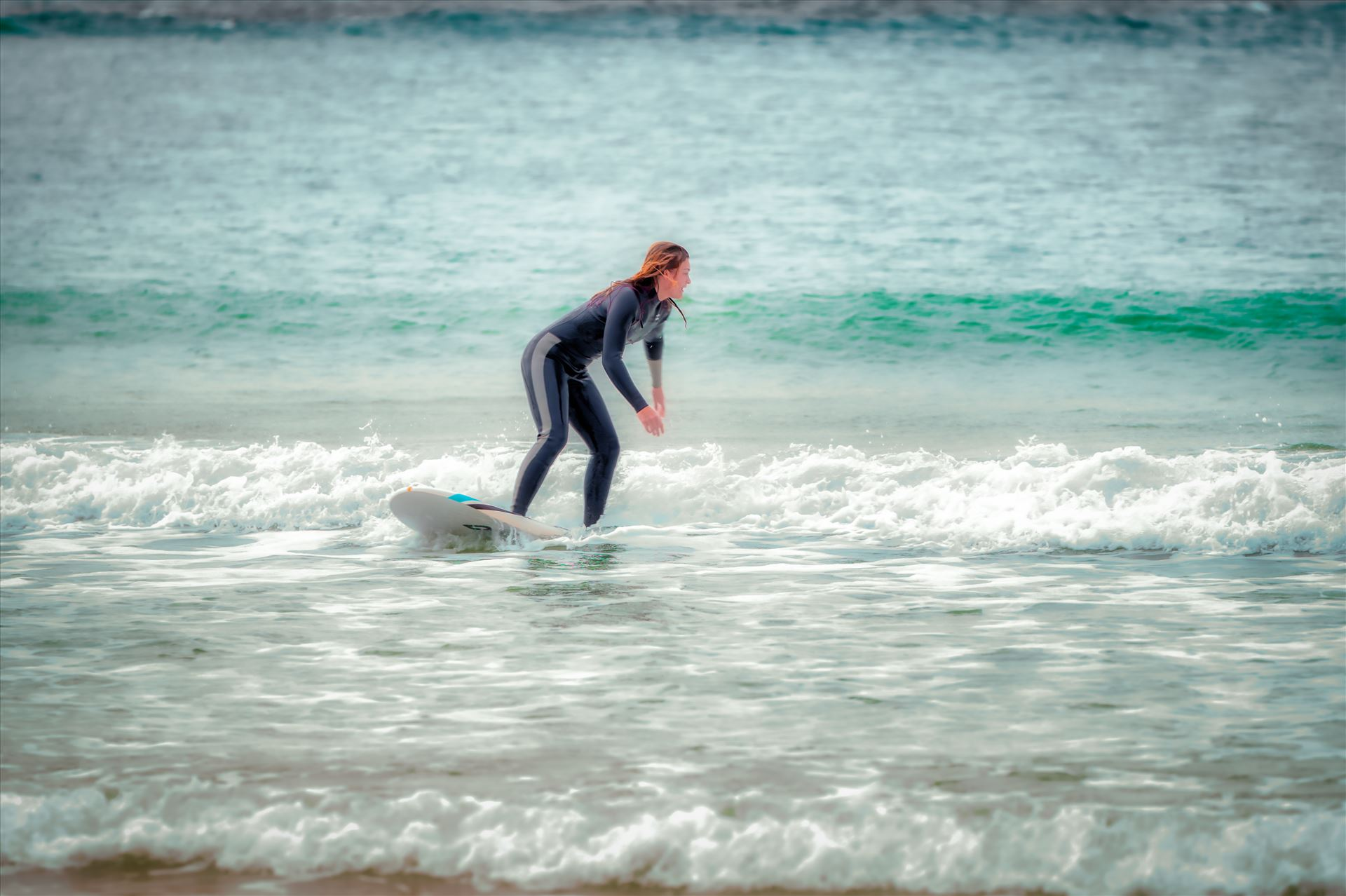 surfer girl Female surfer at St. Andrews State Park at the jetties. by Terry Kelly Photography