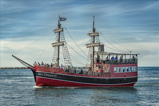 sea dragon pirate ship entering the pass from the gulf of mexico at the jetties st. andrews state park 8500329.jpg by Terry Kelly Photography