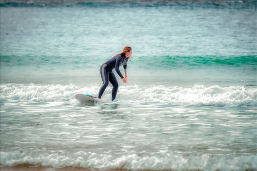 surfer girl - Female surfer at St. Andrews State Park at the jetties.