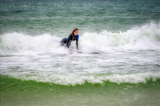 surfer girl - Female surfer at St. Andrews State Park at the jetties