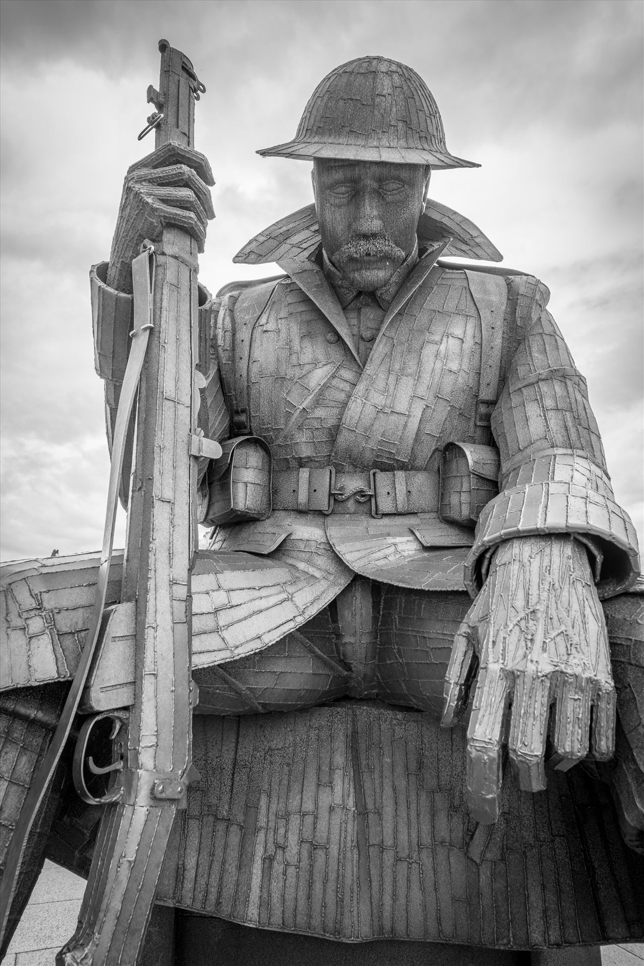 'Tommy' aka 1101 The steel statue weighs 1.2 tonnes, and is 9 feet 5 inches tall. Depicting a WW1 soldier, wearing full uniform, sitting on an ammunition box. Referring to Archetype Tommy Atkins. '1101' refers to the 1st minute of peace in 1918. by Graham Dobson Photography