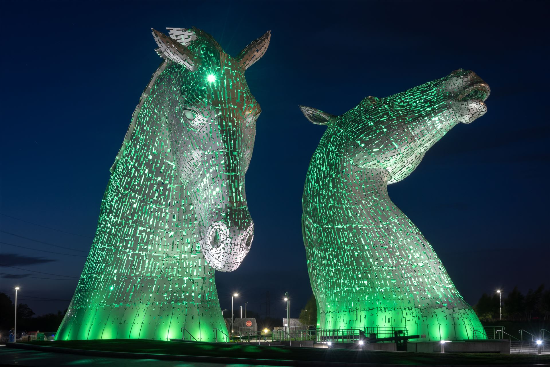 The Kelpies, Falkirk, Scotland - Green Built of structural steel with a stainless steel cladding, The Kelpies are 30 metres high and weigh 300 tonnes each. Construction began in June 2013 by Graham Dobson Photography