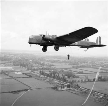 Parachute_troops_jump_from_a_Whitley_bomber_during_a_demonstration_for_the_King_near_Windsor,_25_May_1941._H9955.jpg by Tony