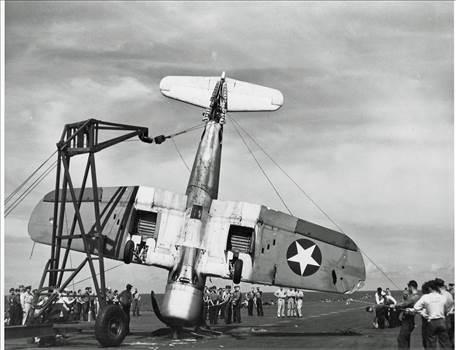 F4U-1CorsairaircraftofVF-17isbeingliftedfromthedeckofUSSBunkerHillCV-17_zps1938c7a8.jpg~original.jpeg by modeldad