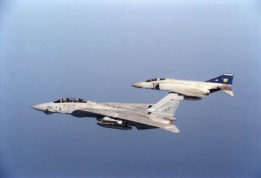 F-14A_Tomcat_of_VF-32_in_flight_with_Phantom_FGR.2_of_19_Squadron_RAF_on_21_December_1990.jpg by At Sea