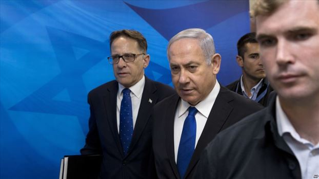 Israeli Prime Minister Benjamin Netanyahu, center, arrives with Cabinet Secretary Tzachi Braverman to the weekly cabinet meeting at the Prime Minister by mohsen dehbashi