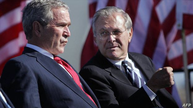 (FILES) In this file photo taken on October 14, 2006 US President George W. Bush (L) talks with Secretary of Defense Donald Rumsfeld (R) at the United by mohsen dehbashi