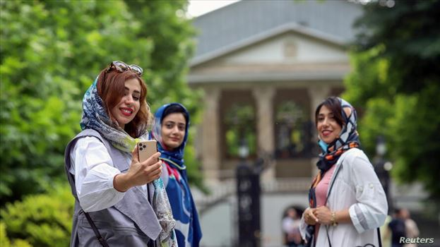 Iranian women take a selfie at a park in Tehran, Iran May 26, 2021. Majid Asgaripour/WANA (West Asia News Agency) via REUTERS ATTENTION EDITORS - THIS by mohsen dehbashi