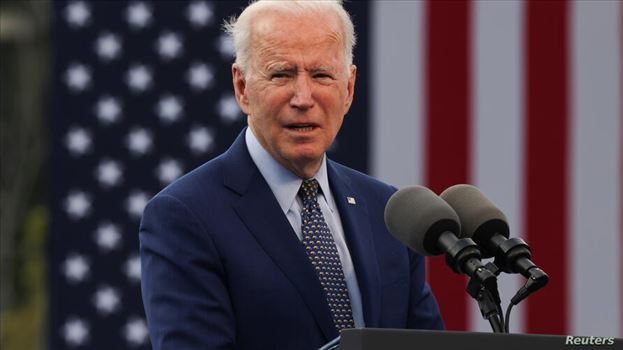 """U.S. President Joe Biden speaks during the Democratic National Committee's """"Back on Track"""" drive-in car rally to celebrate the president's 100th day i by mohsen dehbashi"""