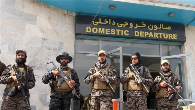 Taliban forces stand guard a day after the U.S. troops withdrawal from Hamid Karzai International Airport in Kabul, Afghanistan August 31, 2021. REUTE by mohsen dehbashi