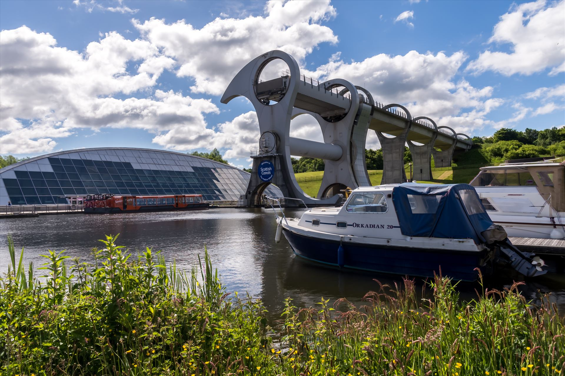 The Falkirk Wheel The Falkirk Wheel is a rotating boat lift in Scotland, connecting the Forth and Clyde Canal with the Union Canal. It opened in 2002, reconnecting the two canals for the first time since the 1930s as part of the Millennium Link project. by philreay