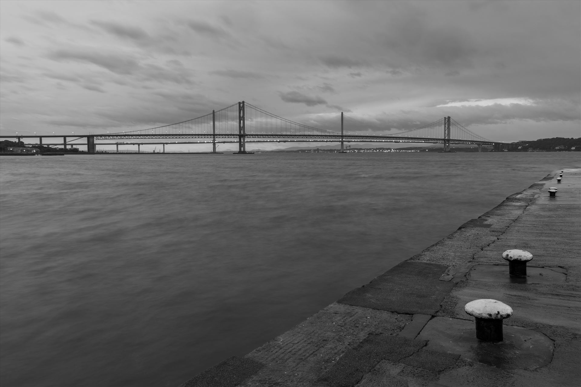 New & old Pictured here are the new & old road bridges across the Firth of Forth nr Edinburgh. by philreay