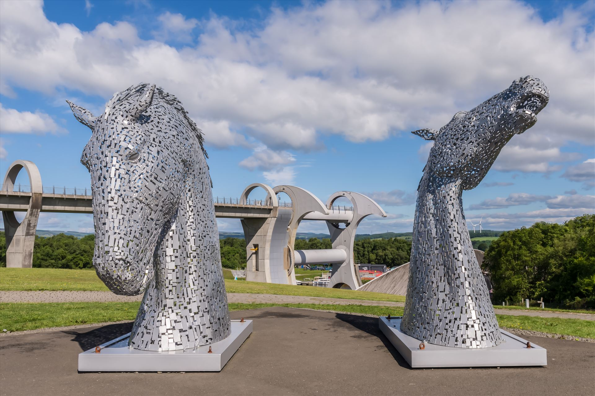 The Falkirk Wheel & miniature Kelpies The Falkirk Wheel is a rotating boat lift in Scotland, connecting the Forth and Clyde Canal with the Union Canal. It opened in 2002, reconnecting the two canals for the first time since the 1930s as part of the Millennium Link project. by philreay