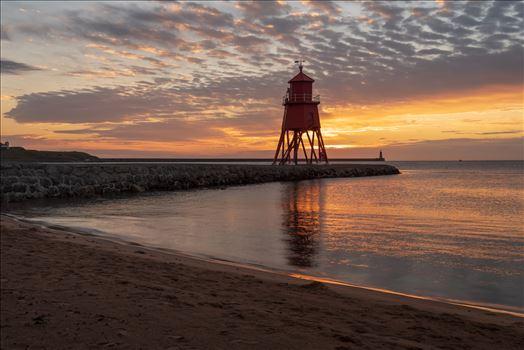 Herd Groyne lighthouse, South Shields at sunrise -