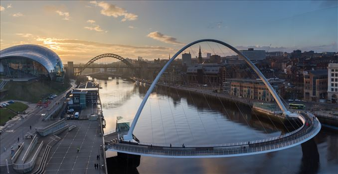 Gateshead \u0026 Newcastle quaysides at sunset - Taken from the viewing platform on level 4 of the Baltic arts building. This photo is made from 3 separate images stitched together to make this panoramic shot.