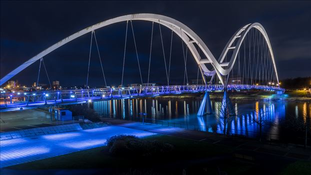 The Infinity Bridge is a public pedestrian and cycle footbridge across the River Tees in the borough of Stockton-on-Tees in the north-east of England. The name derives from the infinity symbol formed by the bridge and its reflection.