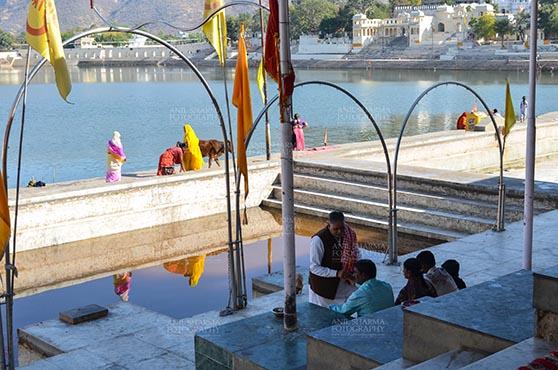 Fairs- Pushkar Fair (Rajasthan) Pushkar, Rajasthan, India- January 16, 2018: A prist helping Hindu family to perform puja ritual at the holy Pushkar Sarovar, Hindu Pilgrimage site, at Rajasthan, India. by Anil Sharma Fotography