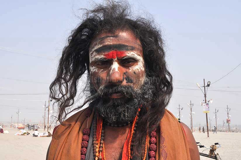 Culture- Aghori Sadhu, Uttar Pradesh (India). Aghori Sadhu with long hairs, ash and tilak on face wearing rudraksha bead at Mahakumbh mela, Allahabad, Uttar Pradesh, India. by Anil Sharma Fotography