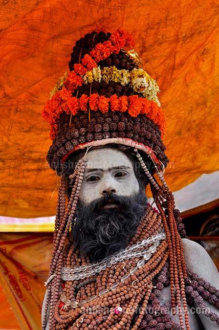 Culture- Naga Sadhu's (India) Naga Sadhu with headdress of Rudraksha bead and marigold malas at Varanasi. by Anil Sharma Fotography