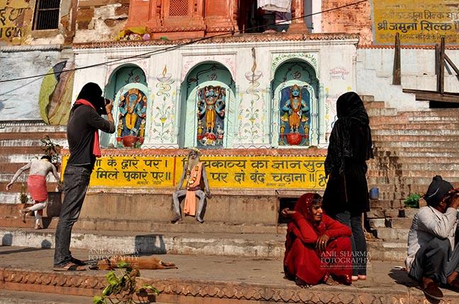 Travel- Varanasi the city of light (India) A photographer taking picture of a Naga Sadhu at Varanasi, Uttar Pradesh, India. by Anil Sharma Fotography