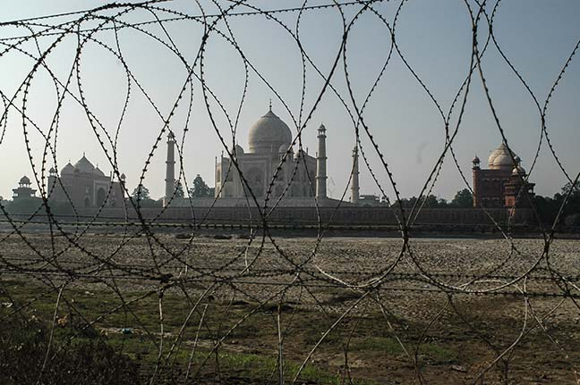 Monuments- Taj Mahal, Agra (India) Barbed-wire fencing at Taj Mahal to protect it from terrorist attacks. by Anil Sharma Fotography