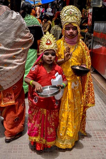 Travel- Gangotri (Uttarakhand) Gangotri, Uttarakhand, India- June 14, 2013: Two local kids dressed up as Goddess Ganga are bagging for alms in Gangotri, Uttarakhand, India. by Anil Sharma Fotography