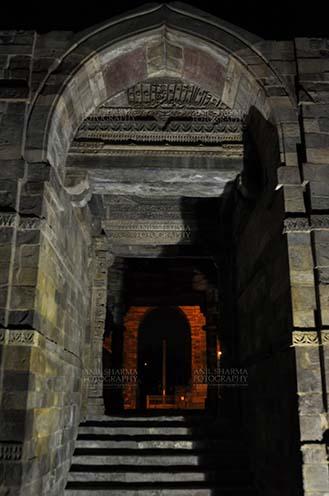 Monuments- Qutab Minar in Night, New Delhi, India. Quwwat-Ul- Islam mosque enterence in night at Qutub Minar Complex, Mehrauli , New Delhi, India. by Anil Sharma Fotography