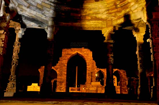 Monuments- Qutab Minar in Night, New Delhi, India. Qutab Minar, Mehrauli, New Delhi, India- October 25, 2010: Beauty of arches of  Iltutmish screen and iron pillar in night at Qutub Minar Complex, Mehrauli , New Delhi, India. by Anil Sharma Fotography