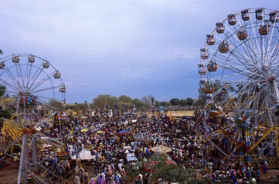 Fairs- Pushkar Fair (Rajasthan) Pushkar, Rajasthan, India- May 23, 2008: Ferris wheel and Large number of tourists at Pushkar fair, Rajasthan, India. by Anil Sharma Fotography