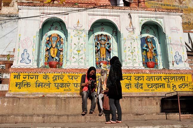 Travel- Varanasi the city of light (India) A photographer showing picture to Naga Sadhu at Ghats at Varanasi, Uttar Pradesh, India. by Anil Sharma Fotography