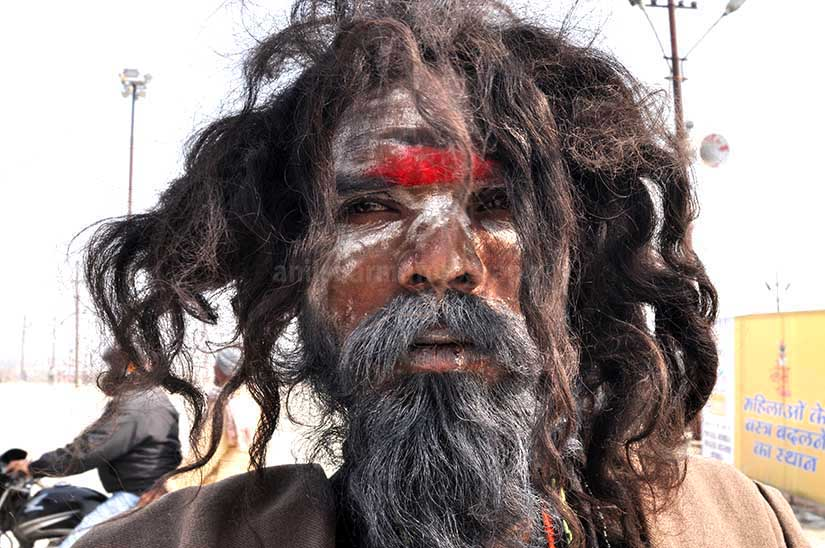Culture- Aghori Sadhu, Uttar Pradesh (India). Close-up of a Aghori Sadhu with long hairs, wearing rudraksha bead at Mahakumbh, Allahabad, Uttar Pradesh, India. by Anil Sharma Fotography