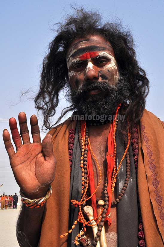 Culture- Aghori Sadhu, Uttar Pradesh (India). Aghori Sadhu with long hairs, ash and tilak on face wearing human bones and  rudraksha bead at Mahakumbh mela, Allahabad, Uttar Pradesh, India. by Anil Sharma Fotography
