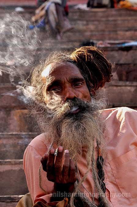 Culture- Naga Sadhu's (India) A Naga Sadhu smoking  bidi at Varanasi ghat. by Anil Sharma Fotography