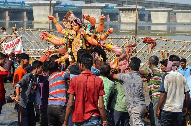 Festivals- Durga Puja Festival Durga Puja Festival, New Delhi, India-September 30, 2017: The Idol of Goddess Durga before the final immersion into the river Yamuna at Kalindi Kunj, New Delhi, India. by Anil Sharma Fotography