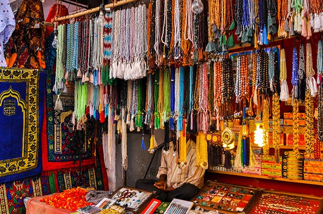 Religion- Dargah Sharif, Ajmer, Rajasthan (India) Beads and stones being sold at shrine market place of Ajmer Sharif Dargah the Mausoleum of Moinuddin Chishti, a sufi saint from India at Ajmer, Rajasthan, India. by Anil Sharma Fotography
