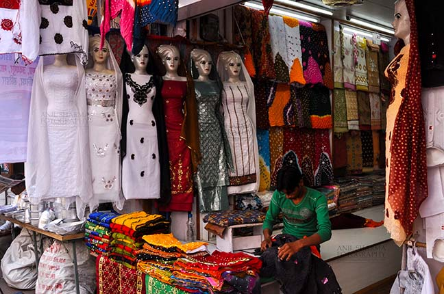 Religion- Dargah Sharif, Ajmer, Rajasthan (India) Ladies suits being sold at shrine market place of Ajmer Sharif Dargah the Mausoleum of Moinuddin Chishti, a sufi saint from India at Ajmer, Rajasthan, India. by Anil Sharma Fotography