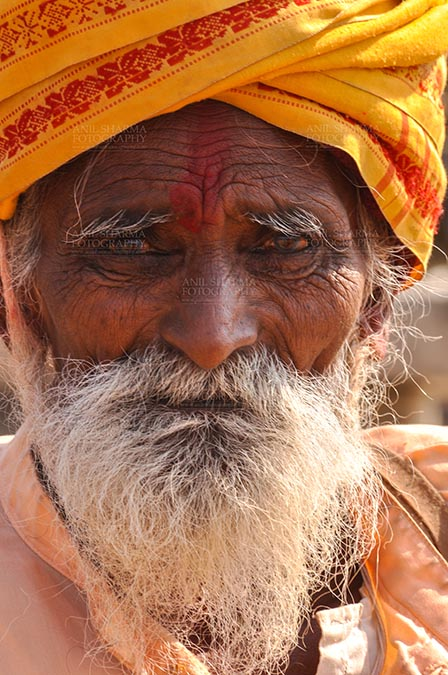 Fairs- Baneshwar Tribal Fair Baneshwar, Dungarpur, Rajasthan, India- February 14, 2011: An old Bhil devotee at Mahadev temple at Baneshwar Dungarpur, Rajasthan, India by Anil Sharma Fotography