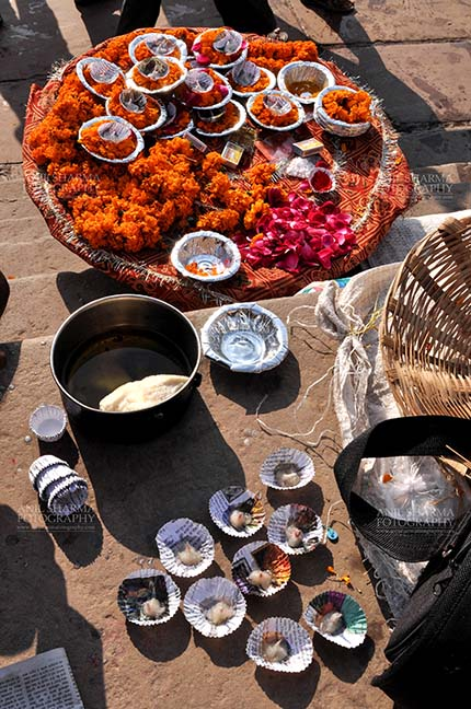 Travel- Varanasi the city of light (India) Hindu devotees use marigold, raised flowers, cotton, ghee, red powder and other material in puja. by Anil Sharma Fotography