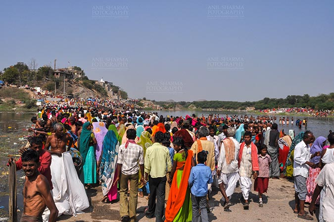 Fairs- Baneshwar Tribal Fair Baneshwar, Dungarpur, Rajasthan, India- February 14, 2011: Large number of devotees ready for the traditional ritual bath at the confluence of the rivers, Mahi and Som at Baneshwar, Dungarpur, Rajasthan, India by Anil Sharma Fotography