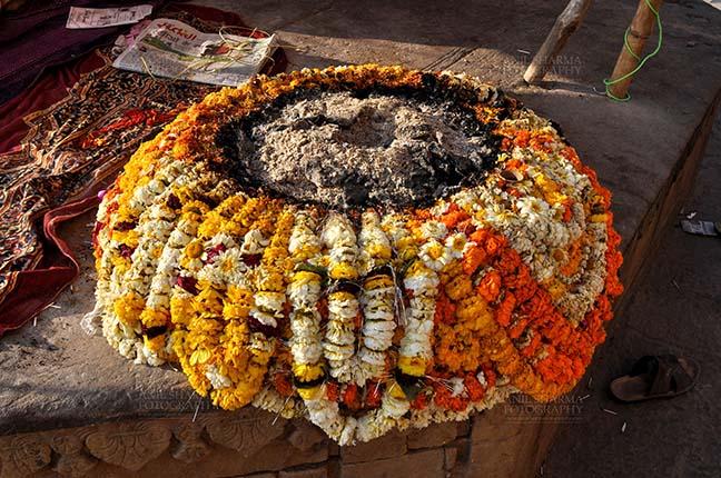 Travel- Varanasi the city of light (India) Beautifully designed fire place with marigold garlands on ghat at Varanasi, Uttar Pradesh, India. by Anil Sharma Fotography