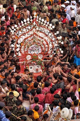 Festivals- Jagannath Rath Yatra (Odisha) Deity of Balbhadra being taken to the chariot on the occasion of Rath Yatra at Puri, Odisha, India. by Anil Sharma Fotography