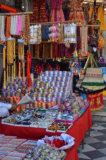 Fairs- Pushkar Fair (Rajasthan) Pushkar, Rajasthan, India- May 23, 2008: Necklaces, beads, jewelry, gemstones, bracelets, earrings, bangles at Pushkar fair, Rajasthan, India. by Anil Sharma Fotography